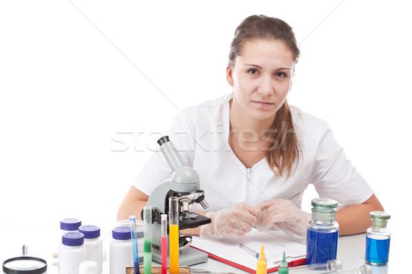 Scientist and microscope Stock photo © grafvision
