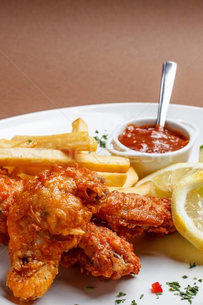 Spicy breaded chicken legs Stock photo © grafvision
