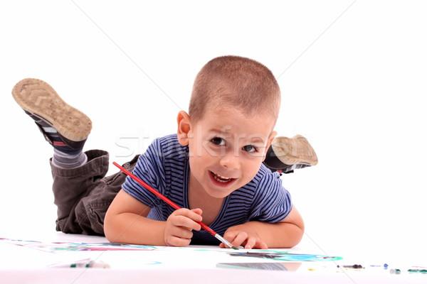 Erkek boyama beyaz kâğıt ev Stok fotoğraf © grafvision