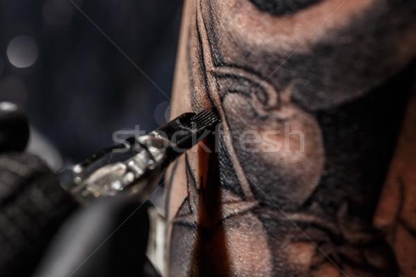 Artist tattooing of man's skin Stock photo © grafvision