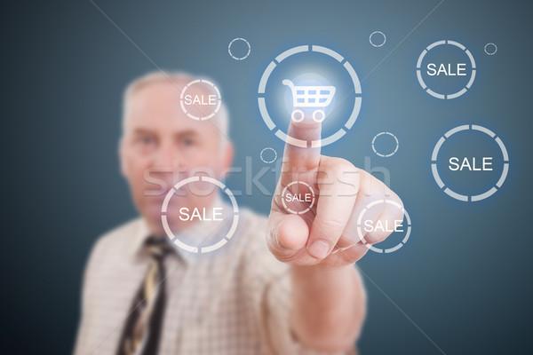 Bevásárlókocsi ikon férfi kéz kisajtolás számítógép Stock fotó © grafvision