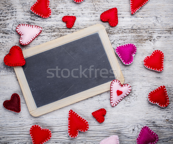 Chalkboard with felt hearts Stock photo © grafvision