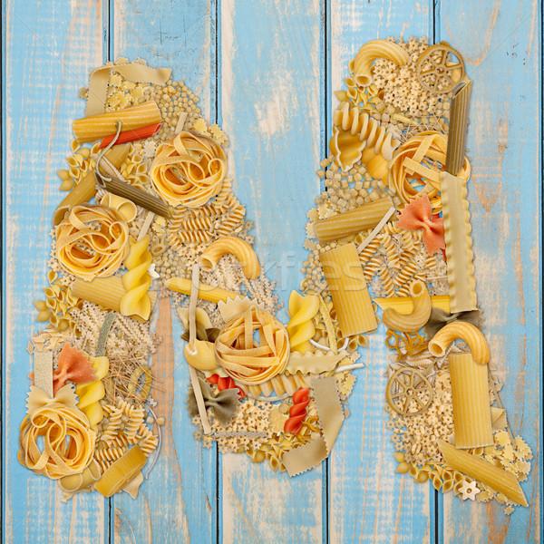 Lettera m pasta blu legno alimentare sfondo Foto d'archivio © grafvision