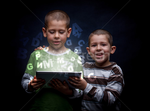 Boys using tablet Stock photo © grafvision