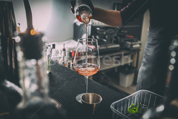Bartender pouring wine Stock photo © grafvision