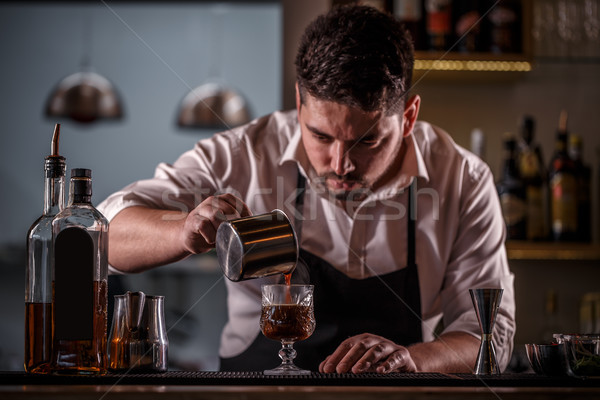 Barman pouring coffee Stock photo © grafvision