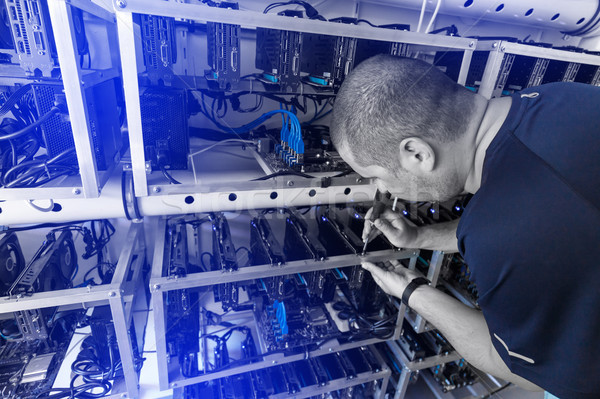 Programmer adjusting cryptocurrency mining rig Stock photo © grafvision