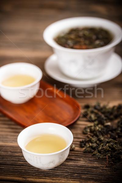 Chińczyk puchar drewna pozostawia herbaty puli Zdjęcia stock © grafvision