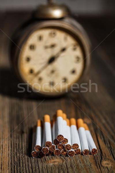 Cigarette temps pause habitude horloge médicaux Photo stock © grafvision