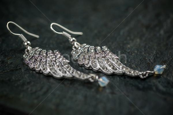 Afbeelding paar oorbellen zwarte mode achtergrond Stockfoto © grafvision