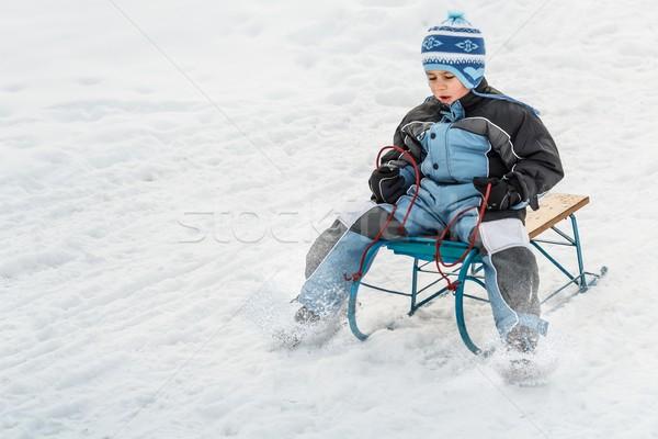 Boy sledding Stock photo © grafvision
