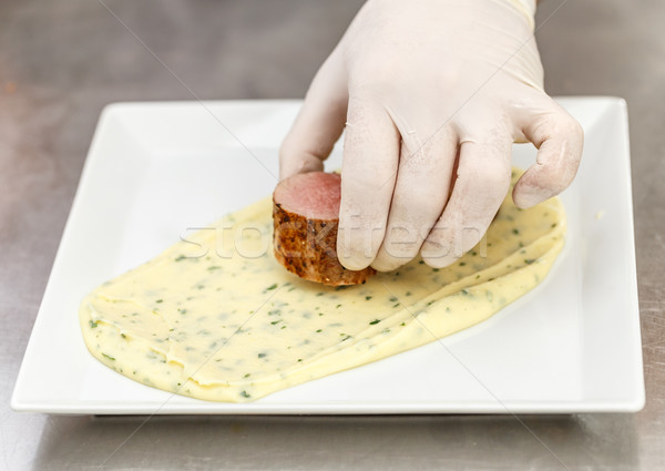 Chef garnishing a plate Stock photo © grafvision
