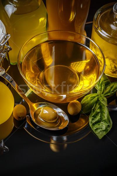 Extra maagd olijfolie klein kom olijven Stockfoto © grafvision