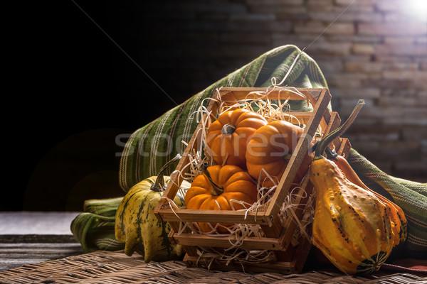 Pumpkins in crate Stock photo © grafvision