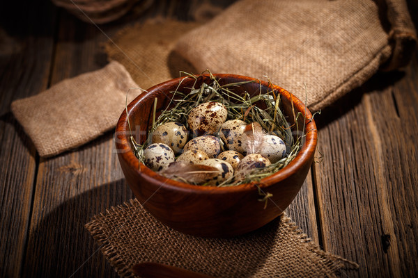 Quail eggs in wooden bowl Stock photo © grafvision