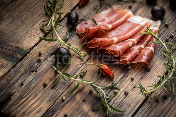 Prosciutto szeletek klasszikus fa asztal vacsora fekete Stock fotó © grafvision