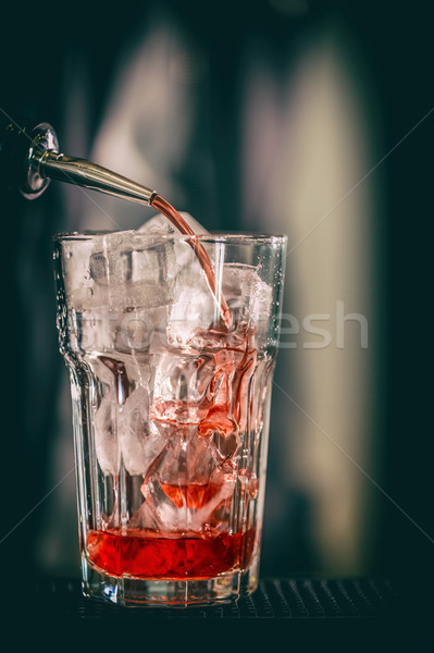 Pouring red sweet drink  Stock photo © grafvision