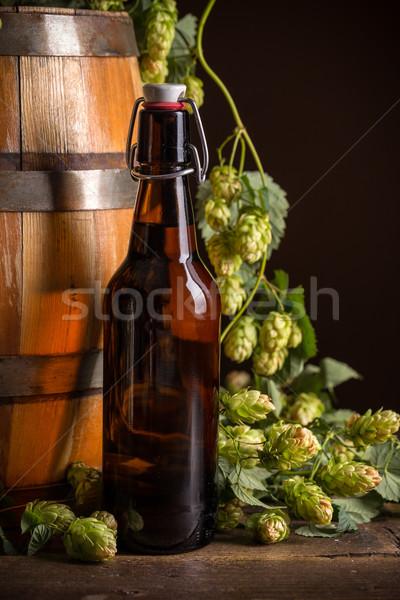 Stilleven bierfles houten vat achtergrond drinken Stockfoto © grafvision