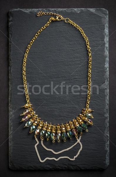 Colar pedras topo ver preto metal Foto stock © grafvision