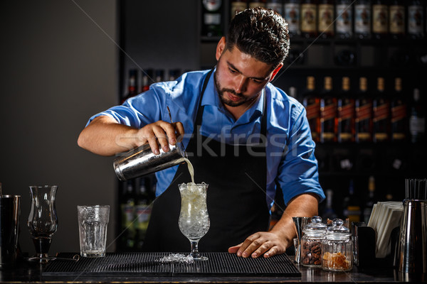 Barman shaker pina colada cocktail bar man Stockfoto © grafvision