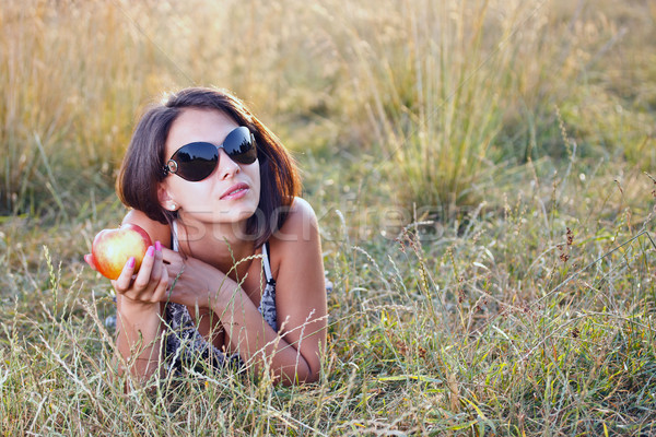 Young woman holding apple in her hand  Stock photo © grafvision