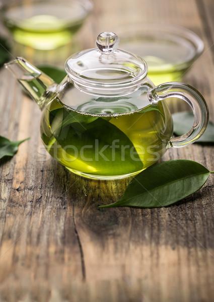 Verre théière thé vert laisse bois surface Photo stock © grafvision