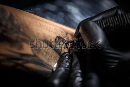 Tattoo artist creating a tattoo  Stock photo © grafvision