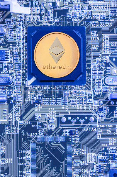 Printed circuit board with a processor and a ethereum symbol Stock photo © grafvision