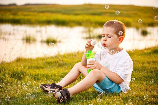 Fiú buborékfújás park fiatal srác víz arc Stock fotó © grafvision