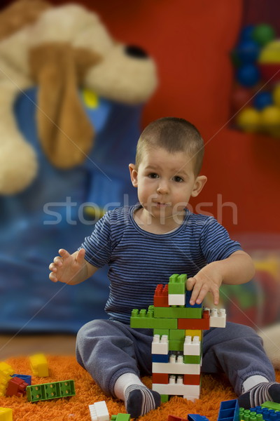 Little boy playing with toy blocks Stock photo © grafvision