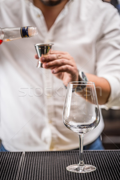 Bartender pouring liqueur Stock photo © grafvision