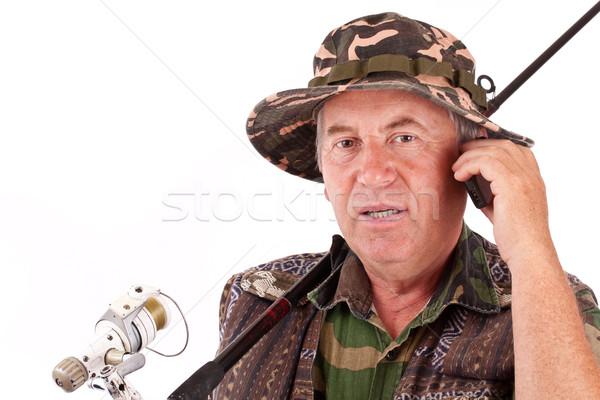 Senior pescador isolado branco falante celular Foto stock © grafvision