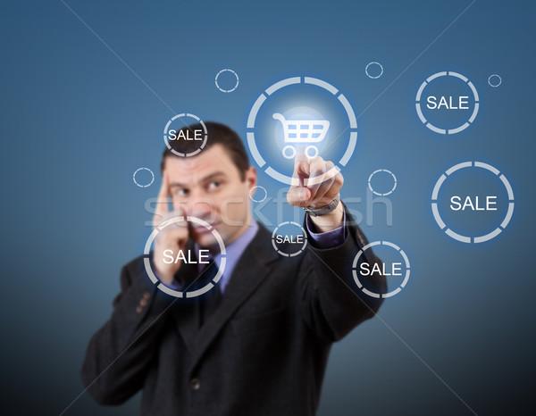 Férfi kisajtolás bevásárlókocsi gomb üzletember futurisztikus Stock fotó © grafvision