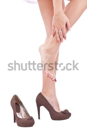 woman rubbing her leg Stock photo © grafvision