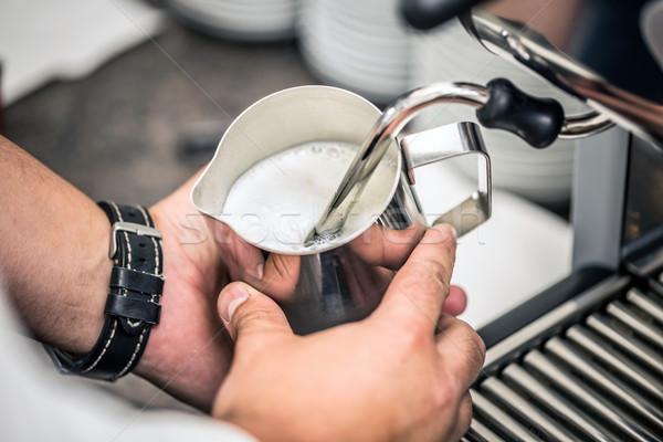 Barista süt sıcak makine içmek Stok fotoğraf © grafvision