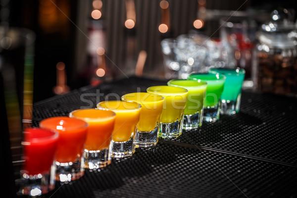 Fila Rainbow colori servito bar counter Foto d'archivio © grafvision
