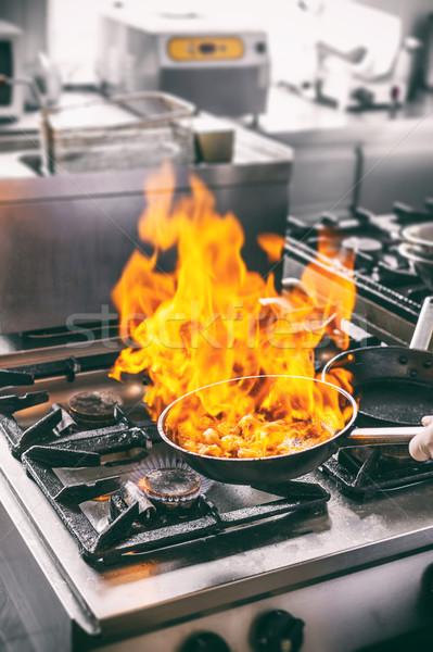 Chef is making flambe sauce Stock photo © grafvision