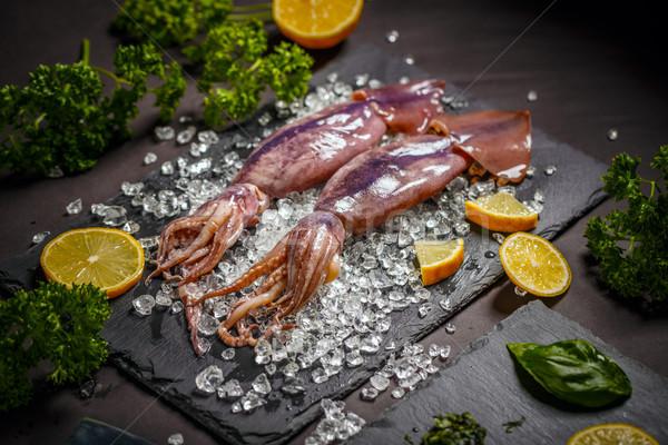 Fresche calamari pesce ghiaccio carne nero Foto d'archivio © grafvision