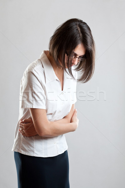 Business woman with stomach issues Stock photo © grafvision