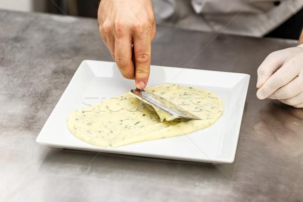 Chef garnishing his dish Stock photo © grafvision