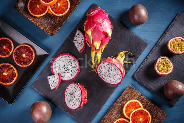 Tropische vruchten draak vruchten zwarte voedsel oranje Stockfoto © grafvision