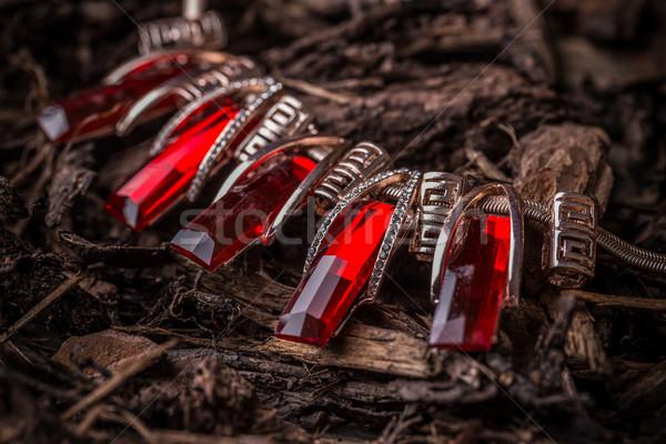 Fém nőies nyaklánc piros hegyikristály háttér Stock fotó © grafvision