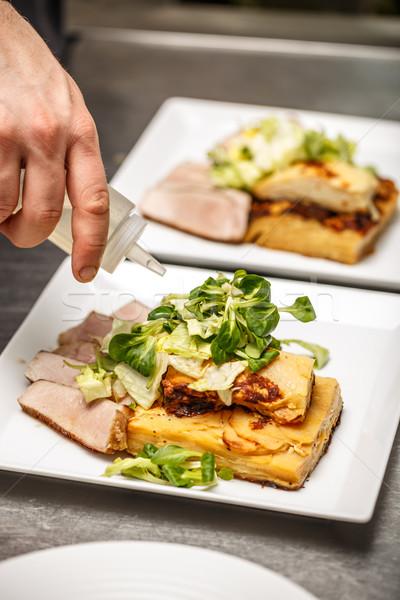 Chef touch piatto cucina cena Foto d'archivio © grafvision