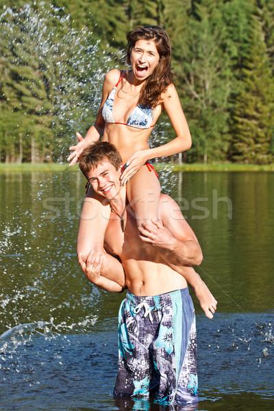 Vakációzás pár fut víz tengerpart nő Stock fotó © grafvision
