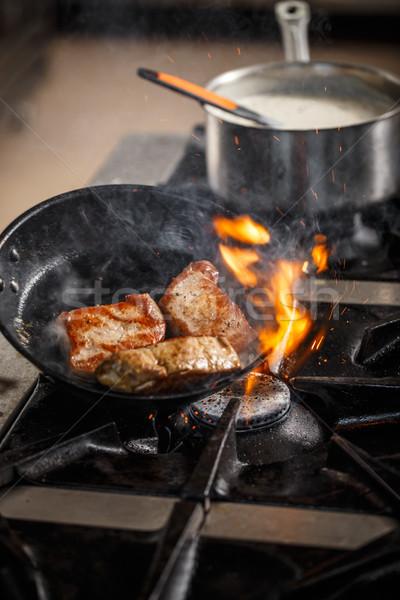 Flame in black pan Stock photo © grafvision