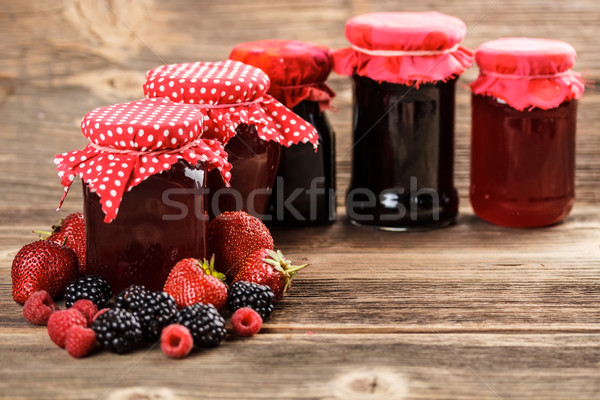 Fruit jam verschillend vol vruchten glas Stockfoto © grafvision