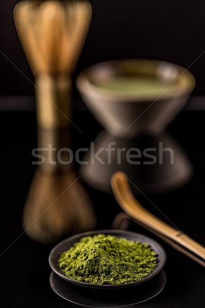 Pó chá verde preto prato fundo verde Foto stock © grafvision