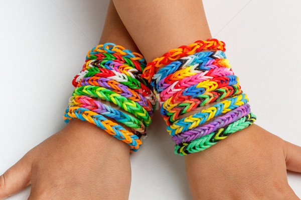 A kid's with rainbow color loom band Stock photo © grafvision
