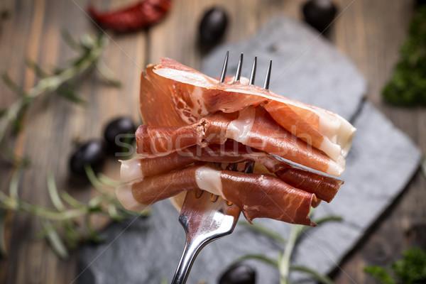 Prosciutto közelkép hús villa sonka közelkép Stock fotó © grafvision