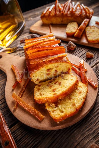 Torta azucarado naranja tabla de cortar madera Foto stock © grafvision
